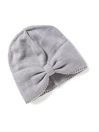 Bonnet en tricot torsadé pour toute-petite fille